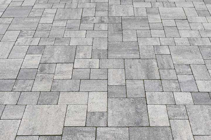 Link to our interlock repair service information. Showing a clean interlocking stone outdoor floor.